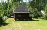 Drewniany dwupoziomowy domek na Mazurach