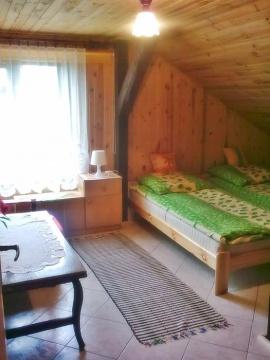 Domek murowany numer jeden sypialnia